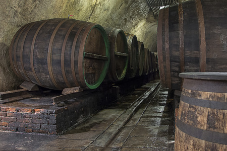 Old, Grungy Traditional Beer Cellar with Oak Barrels