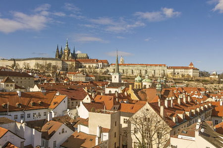 dominant: View at Prague roofs and towers with dominant feature of Prague Castle and the cathedral.