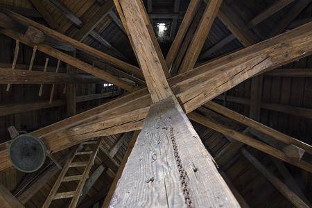 attic: Old wooden beams in attic of historic tower in Prague.