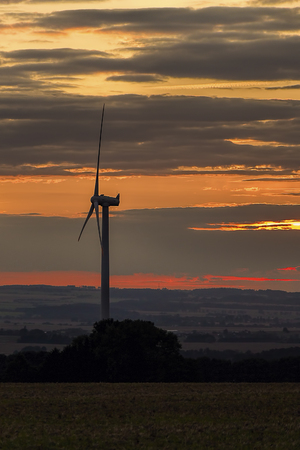 wind power plant: Wind power plant in sunset with dramatic sky.