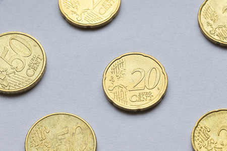 euro coins: Small Euro coins on white paper background.