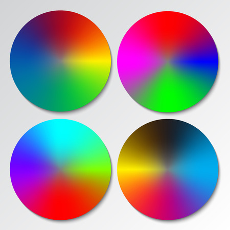 color spectrum: Set of four different color spectrum wheels or circular rainbow gradients.