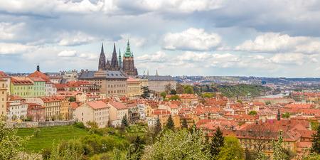 historical architecture: Spring Prague panorama from Prague Hill with Prague Castle, Vltava river and historical architecture.