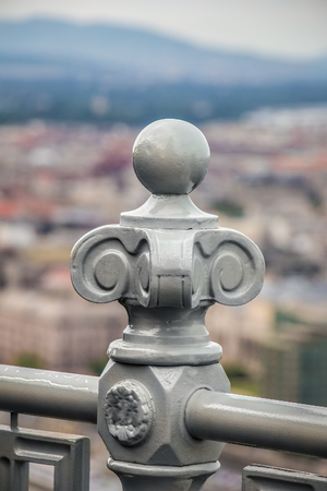 Old vintage ironworks on a balustrade fence in a historic city Stock Photo
