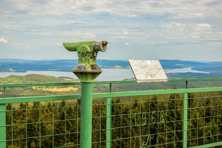 lipno: Vintage coin green lookout binocular with view at Czech countryside, river Vltava, Lipno lake, 200 km south of Prague.