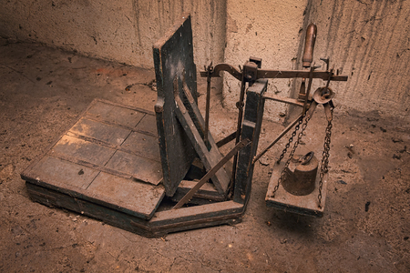 Vintage antique scales in an attic of old country building Stock Photo