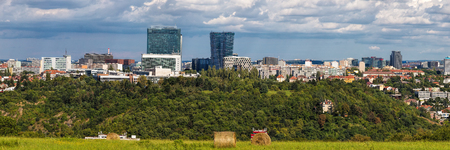 Wide panorama of Pankrac, Prague main business district with modern tall buildings, highest in Prague. Czech Republic, Europe. River Vltava is down in the valley.
