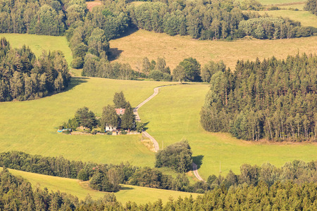 Idyllic landscape, meadows and forests in Sumava, mountains at Czech, Austrian and Germany border, 200 km south of Prague. Aerial view of untouched nature. Stock Photo