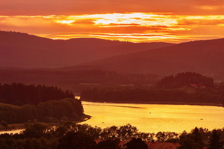 Colorful idyllic sunset landscape at lake Lipno, Czech mountains Sumava,  Bohemian forest or Böhmerwald, Bavarian Forest or Böhmische Wald Stock Photo