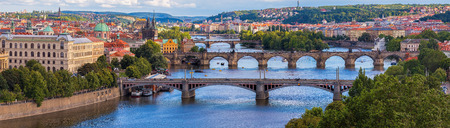 Wide panorama of Prague with river Vltava Charles Bridge and other bridges Standard-Bild