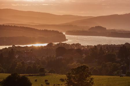 Colorful idyllic evening landscape at lake Lipno, Horni Plana, Czech mountains Sumava,  Bohemian forest Bavarian Forest