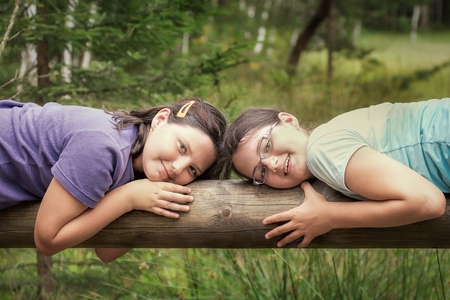 Portrait of two children, girls, sisters in nature. Concept of family life.