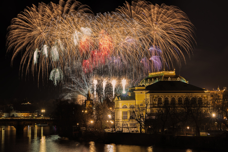 New Year Prague fireworks 2018 over river Vltava, National Theater and historic architecture. Stock Photo