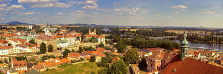 Wide panorama of Litomerice, historic city north of Prague, Check Republic, with Elbe (Labe) river, aerial view.