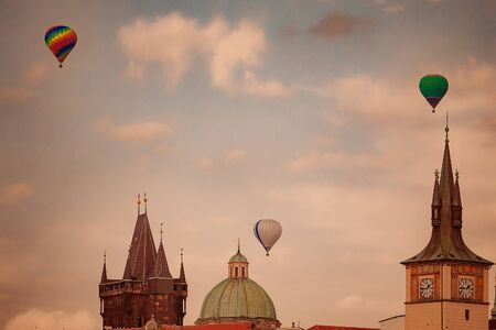 Balloons over Prague roofs and towers