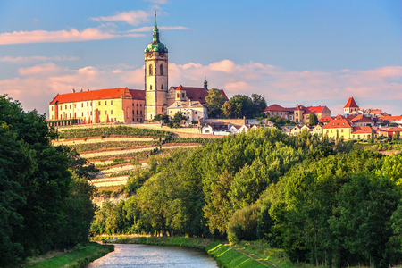 Panorama or skyline or cityscape of historical city Melnik with historical castle and river Vltava and famous vineyards. Melnik is 30 km north of Prague and there is confluence of Vltava and Elbe river