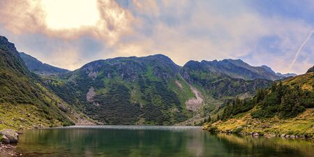 Austria Alps landscape panorama with mountain lake, Kaltenbachsee in Niedere Tauern near Schladming Dachstein