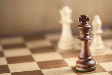 chess pawn: Chess pieces and game board background (Shallow DOF)