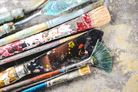 color image creativity: Dirty paint brushes on aluminum tray (Shallow DOF)
