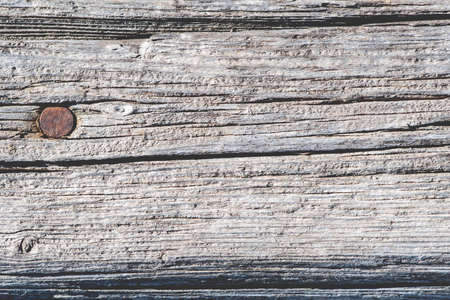 rusty nail: Old rustic wooden background with rusty nail Stock Photo