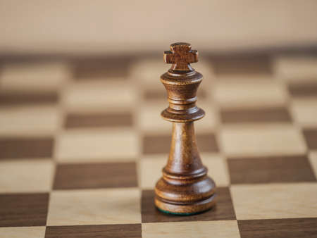 outwit: King chess piece and game board background (Shallow DOF) Stock Photo