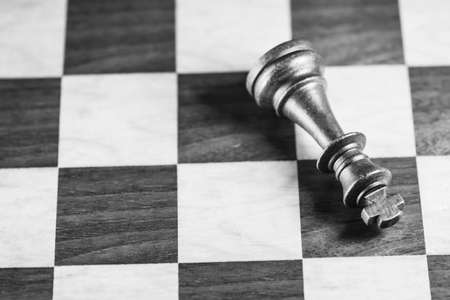 battle plan: Chess pieces and game board background, black and white, shallow DOF