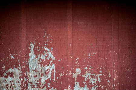 red wall: Old rustic weathered red barn wall in the country