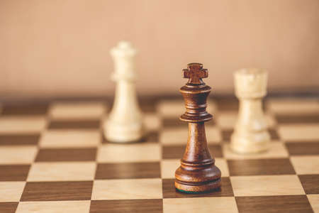 chess rook: Chess pieces and game board background, focus on king, shallow DOF