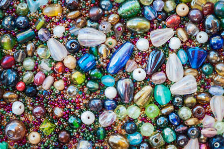 Macro view of a group of vibrant colored beads background, shallow DOF