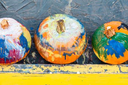 pumpkin pie: Close-up view of three painted holiday pumpkins, shallow DOF