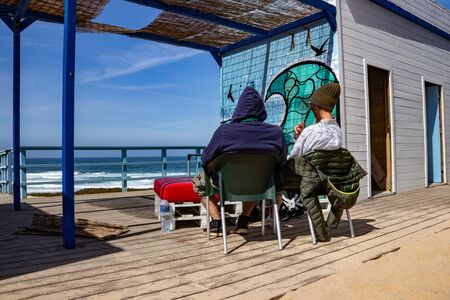 couple relaxing in a patio at a beach club