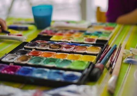 paintbox: paintbox and brushes on colorful table
