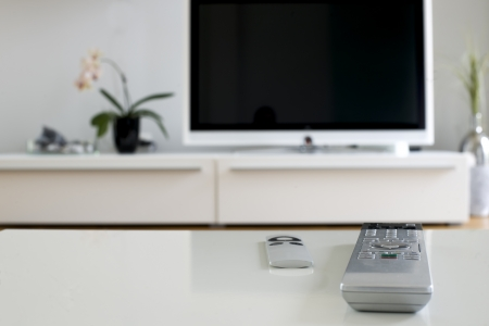 two remotes on white table for home cinema and entertainment photo