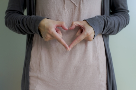 you are special: woman forming heart - sign with hands