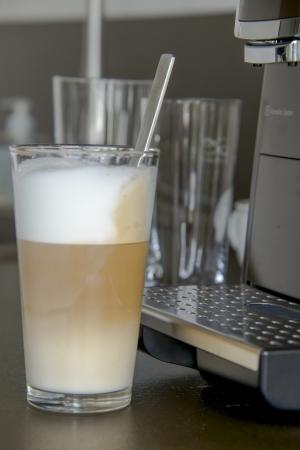 latte macchiato: a glas of fresh prepared latte macchiato