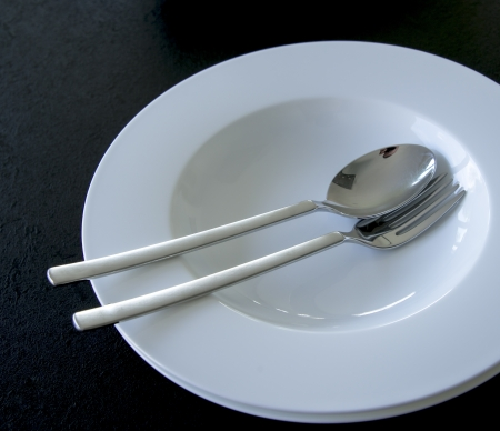 two plates, a fork and a spoon photo