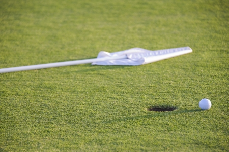 ball and flag on green of golf course Stock Photo - 20243103