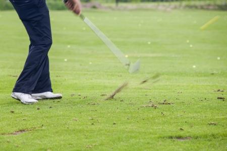 hits: golfer hits golfball