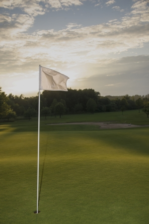 green of golf course during dawn photo
