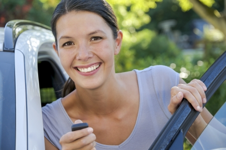 brunette attractive woman shows her new keys for her car photo