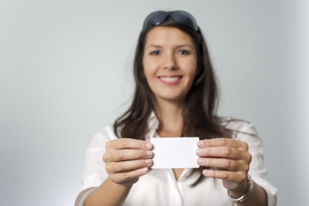 brunette woman takes credit card out of her purse photo