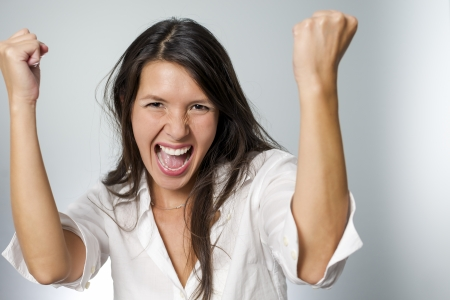 winning woman: woman screaming because of winning excitement Stock Photo