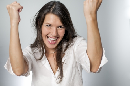 woman screaming because of winning excitement photo