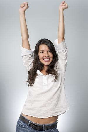éxtasis: mujer gritando a causa de la emoción de ganar Foto de archivo
