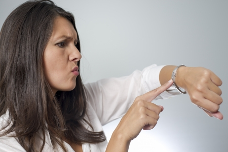 girl with a wristwatch: woman indicating being too late