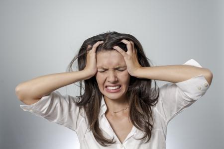 頭痛、否定的な表情を持つ女性 写真素材