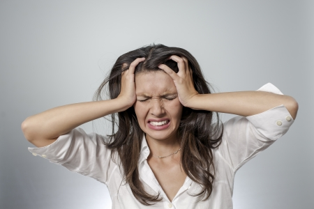 woman with headache and negative face expression Stock Photo