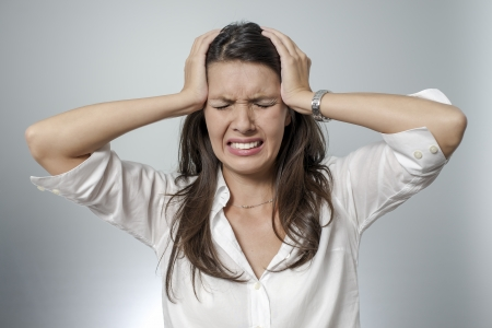 frustration girl: woman with headache and negative face expression Stock Photo