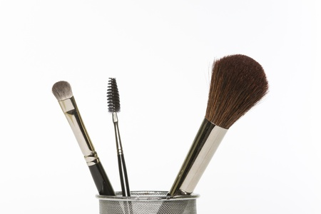 emphasise: Close-up of some feminine make-up and grooming tools and brushes. Stock Photo