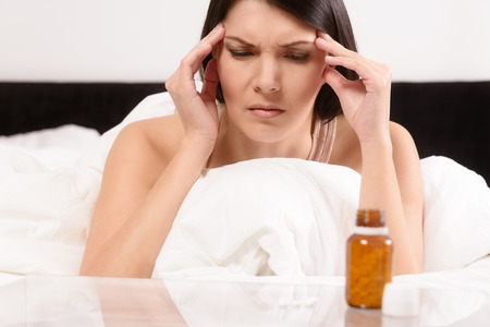 antidepressants: Woman with a migraine headache Stock Photo